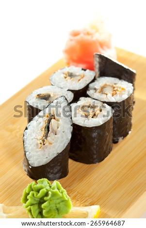 Unagi Maki - Smoked Eel Sushi Roll on the Wooden Plate - stock photo