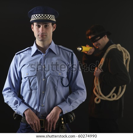 Unaware officer that a crime is being comited. black background. Square format. - stock photo