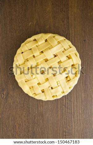Unbaked apple pie with lattice pastry top - stock photo