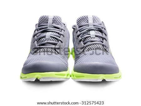 Unbranded sneakers isolated on a white background. - stock photo