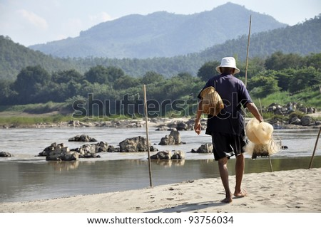 Uncle Fisher Local Man Net Thailand - stock photo