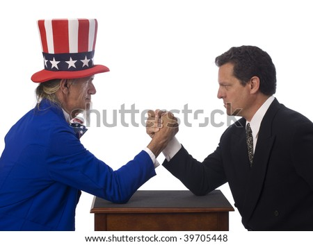 Uncle Sam arm wrestling with a businessman on a white background - stock photo