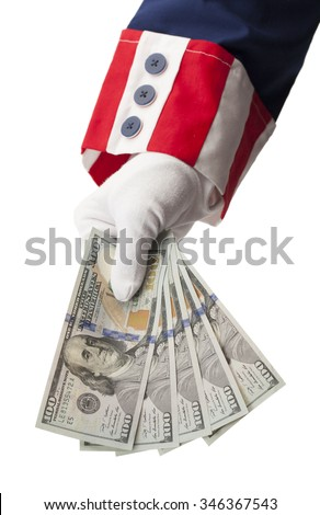 Uncle Sam Handing Holding Money Isolated on White Background. - stock photo