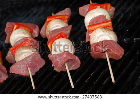 Uncooked beef kabobs on a barbecue  grill - stock photo