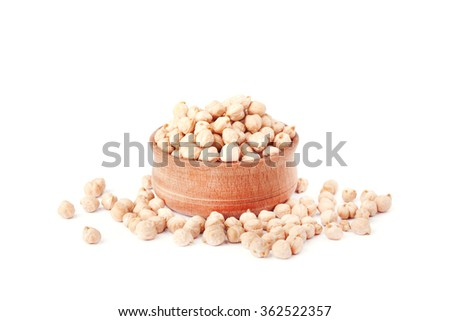 Uncooked chickpeas in wooden bowl on white background - stock photo