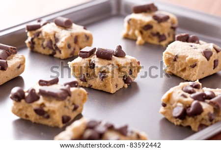uncooked cookie dough on a baking pan - stock photo