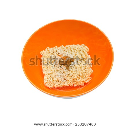 Uncooked dry instant Noodle in orange bowl on the white background - stock photo