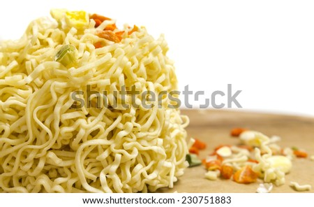 Uncooked dry instant soup with noodle on a white background. Selective focus - stock photo