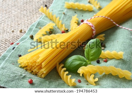 Uncooked gluten free pasta from blend of corn and rice flour - stock photo