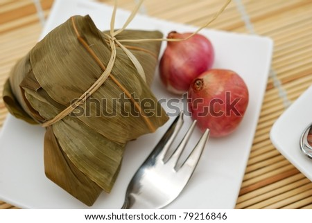 Uncooked glutinous rice ingredient prepared and seasoned for Oriental cooking. - stock photo