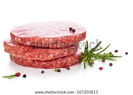 Uncooked hamburgers with rosemary and pepper. Isolated on white background. - stock photo