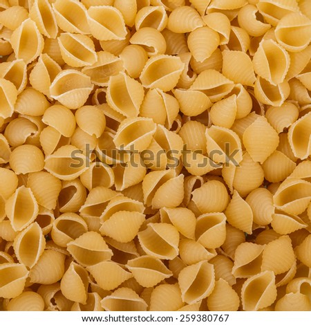 Uncooked italian pasta background - stock photo