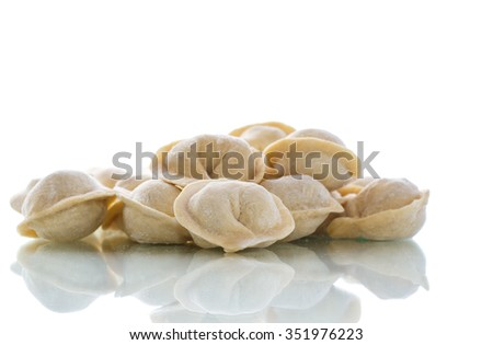 uncooked meat dumplings on a white background  - stock photo