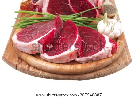uncooked meat : raw fresh beef pork rib and fillet ready to cooking with garlic and green stuff over wood isolated on white background - stock photo