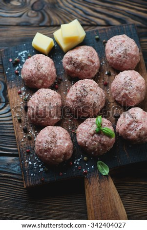 Uncooked meatballs with seasonings, close-up, selective focus - stock photo