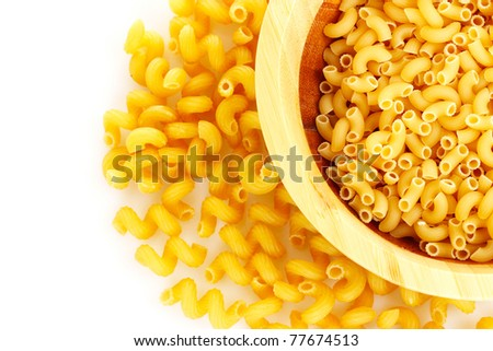 uncooked pasta on a white background - stock photo