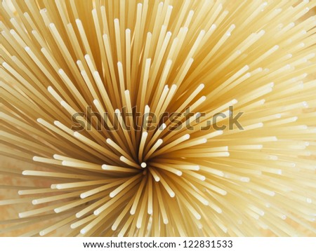 Uncooked pasta spaghetti macaroni isolated - stock photo