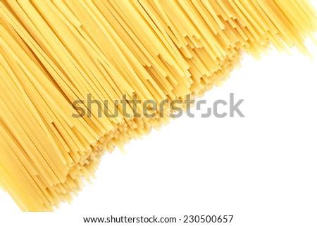 Uncooked pasta spaghetti macaroni isolated on white background - stock photo