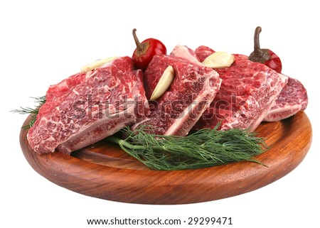 uncooked ribs on wooden tray over white - stock photo
