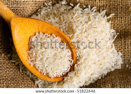 Uncooked rice on a sack - stock photo