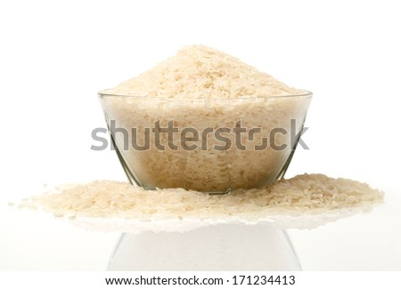 uncooked Rice on white background - stock photo