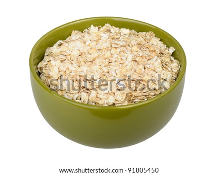 uncooked rolled oats isolated on white background - stock photo