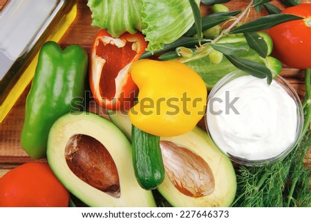 uncooked vegetables prepared for use on table - stock photo