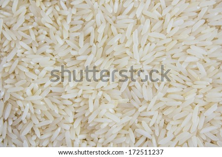 Uncooked white rice background - stock photo