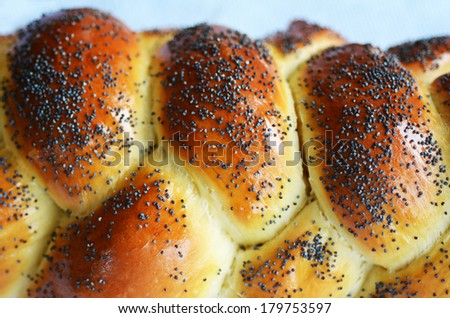 Uncovered challah bread on Sabbath dinner table. close up - stock photo