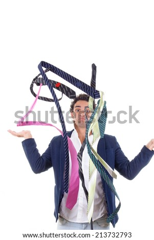 undecided man in suit with lot of ties all around him - stock photo