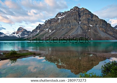 Under a picturesque sunrise, Bow Lake in Alberta, Canada. - stock photo