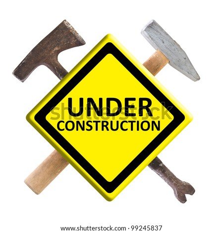 Under construction sign with construction right tools - stock photo