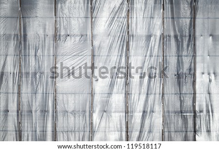 Under construction. Texture of old building facade with protection grid - stock photo