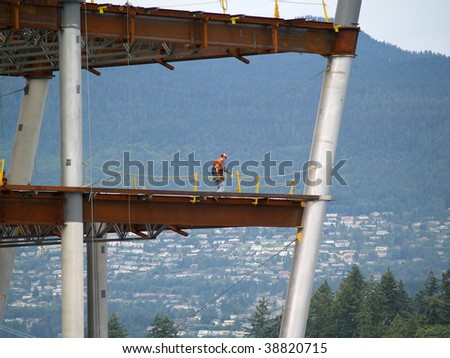 under construction, this worker is walking the iron checking for quality - stock photo