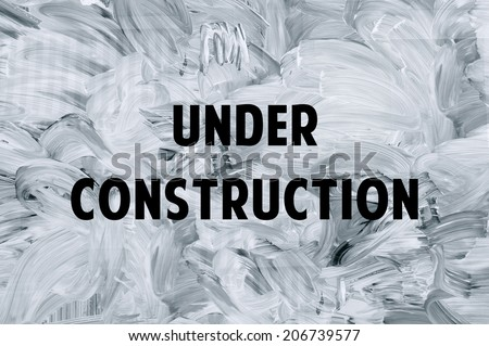 Under construction - white brush marks on the glass. - stock photo