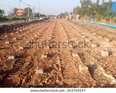 Under constructions of road improvements, a concrete with steel with a point at one end, driven into the ground to support a road, improvements for stronger - stock photo
