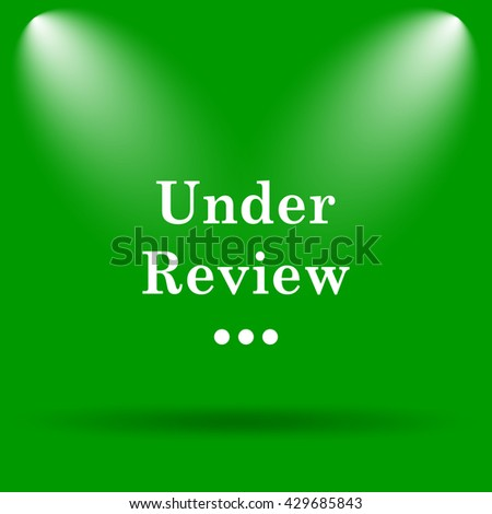 Under review icon. Internet button on green background. - stock photo