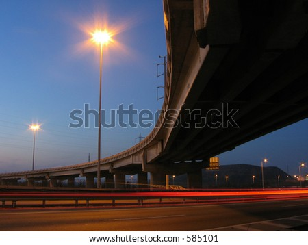 Under the bridge at night - stock photo