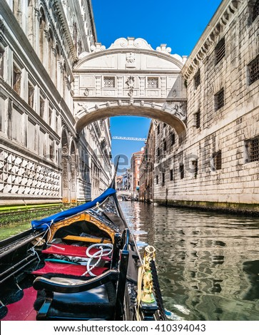Under the Bridge of Sighs, legendary historic bridge, one of famous landmarks in Venice, Italy. / Famous Bridge of Sighs. - stock photo