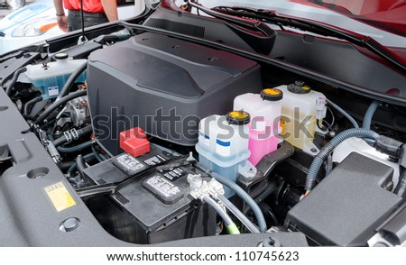 under the hood of an electric car - stock photo
