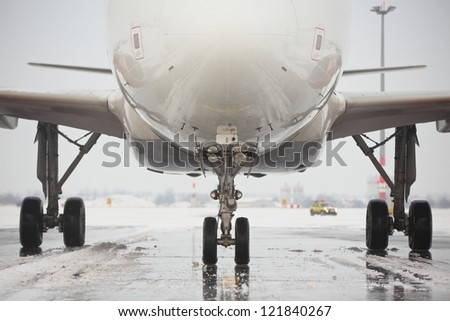 Undercarriage of the airplane in winter, Prague - stock photo