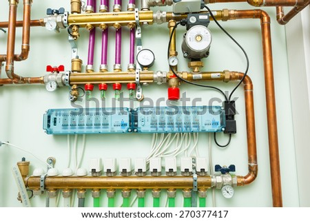 underfloor heating control system in boiler-room - stock photo