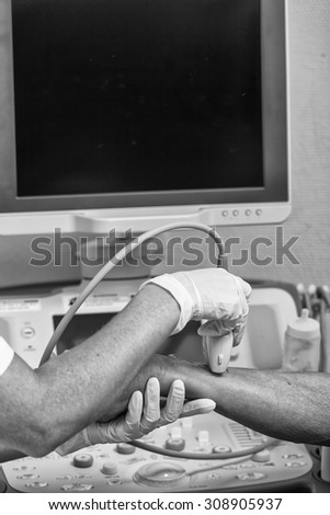 Undergoing medical test in hospital. Ultrasound sonography of human arm. - stock photo