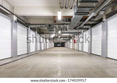 Underground European storage and parking facility with numbered bays. - stock photo