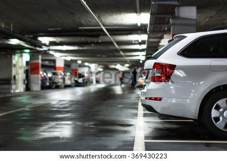 Underground parking/garage (shallow DOF; color toned image) - stock photo