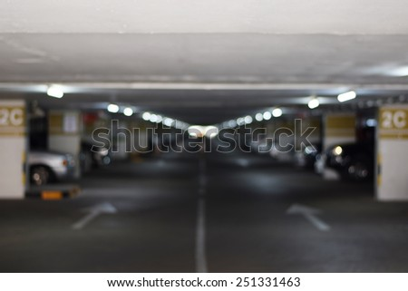 underground parking garage with a few cars(blurred background) - stock photo