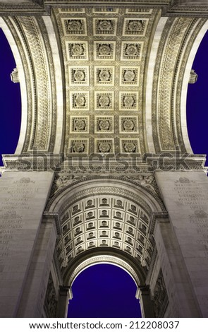 Underneath the magnificent Arc de Triomphe in Paris. - stock photo