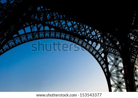 Underneath view of the Eiffel Tower in Paris France - stock photo