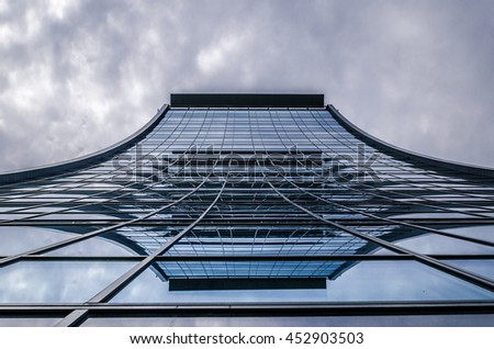 underside panoramic and perspective view to steel blue glass high rise building with reflections, skyscrapers, industrial architecture - stock photo