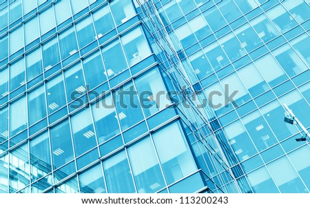 underside perspective view to steel blue glass high rise building skyscrapers, business concept of successful industrial architecture - stock photo